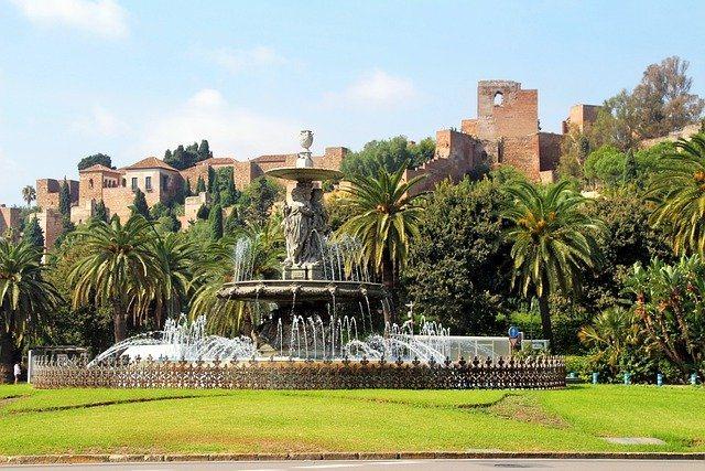 Malaga fountain and Alcazaba