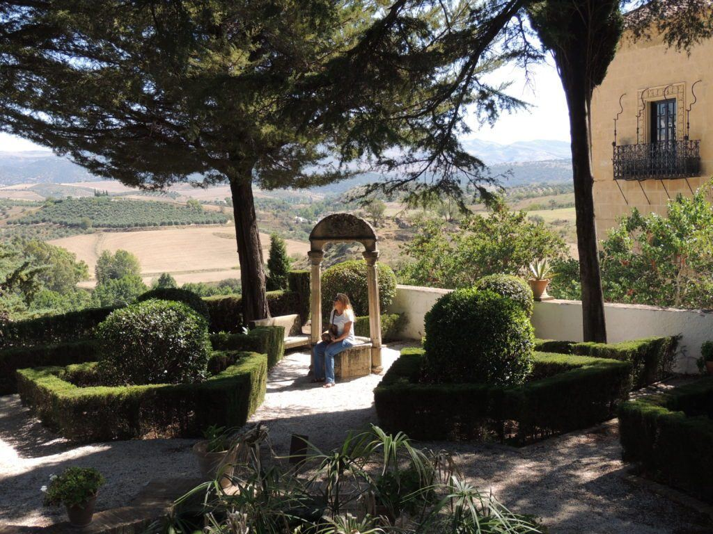 Sitting in the garden of the Casa del Rey Moro