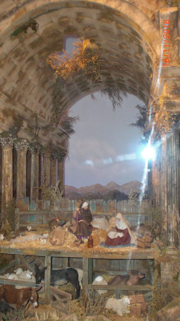 a lovely nativity situated in a ruin with archway