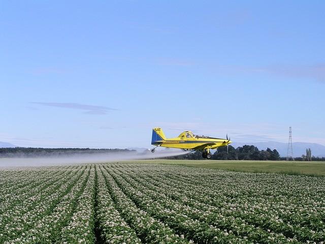 Plane spraying crops