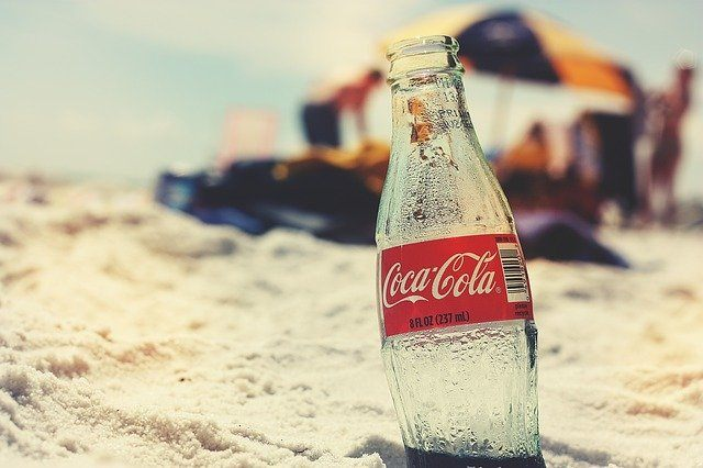 Coca-Cola glass bottle on the beach